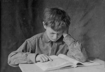 o-lewis-hine-boy-at-school-1924